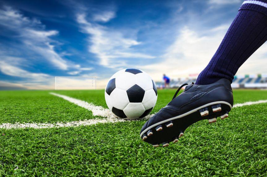 32056069 - foot kicking soccer ball